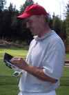IntelliGolfer Joe Buchberger enters his score on his handheld device.